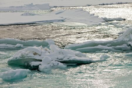 ice floes: Nature background abstract of flowing open river water in winter with jammed ice floes
