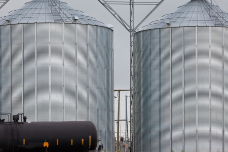 Railway tank wagon and agricultural silos of grain elevator storage and loading facility building exterior Stock Photo - 24609127