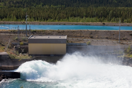 torrential: Violent torrent of white water in spillway of hydro-electric power plant with open gate at dam Stock Photo