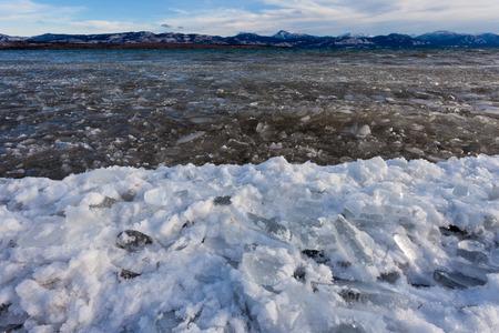 ice floes: Shore ice during freeze-up of Lage Laberge, Yukon Territory, Canada, winter landscape Stock Photo