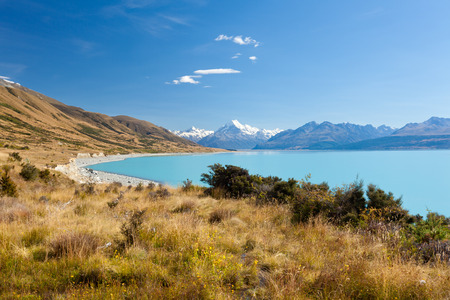 canterbury: Mighty Aoraki Mount Cook towering over glacial Lake Pukaki in hues of turquoise from silt, Aoraki Mount Cook National Park, Canterbury, South Island, New Zealand