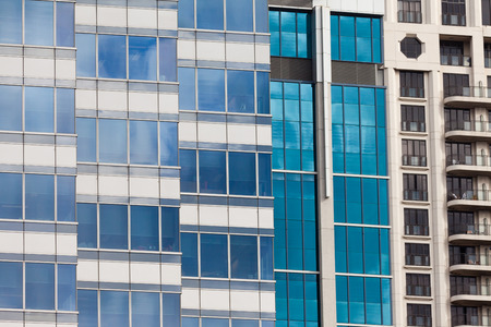 highriser: Background pattern of blue window reflections in a modern coporate office building facade Stock Photo