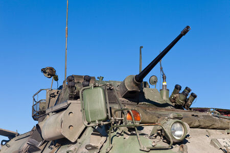 Close up view of the turret, armaments and gun of an operational military armored tank vehicle