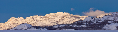 boreal: Snow covered boreal forest taiga hills and mountains panorama of Yukon Territory, Canada Stock Photo
