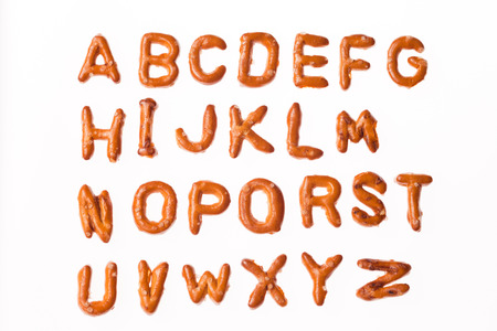Whole alphabet written, laid-out, with crispy alphabet pretzels isolated on white background photo