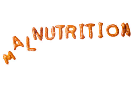 tumbled: Tumbled word MALNUTRITION written, laid-out, with crispy alphabet pretzels isolated on white background Stock Photo