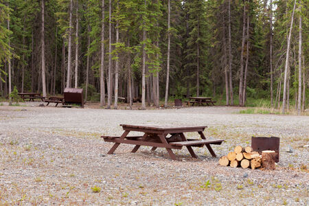campground: Campground on gravelled area inforest with camping table and fire-pit for each campsite