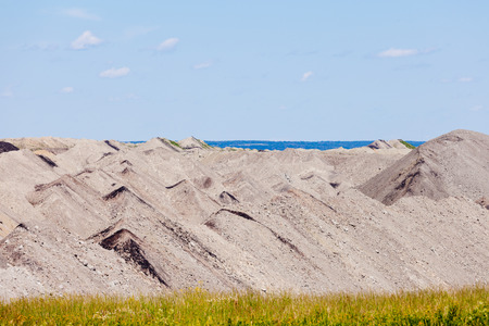 Coal mine tailings moon-like landscape in Alberta, Canada, resource mining industry background abstract