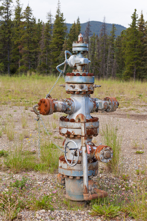 Inoperational oil and gas petroleum industry wellhead flange gear locked shut, Alberta, Canada photo