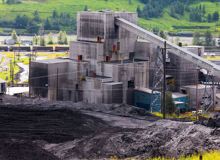 resource: Detail of coal mine black dirty structure between piles of coal fossil energy fuel resource from active mining