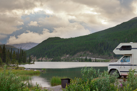 campervan: Camper van parked on Summit Lake Campground in Stone Mountain Provincial Park, highest point of the Alaska Highway, northern BC, Canada