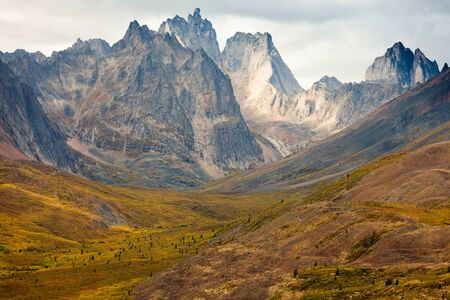 yukon: Autumn fall colors start to arrive in Tombstone Territorial Park near Dempster Highway north of Dawson City, Yukon Territory, Canada Stock Photo