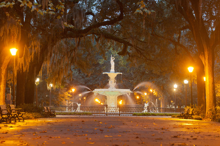 Forsyth Park Fountain famous landmark at night in Historic District of City of Savannah, Georgia, USA