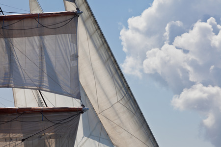 Marine sailing nautical abstract background showing detail of a three masted barquentine yacht square rigged on the foremast