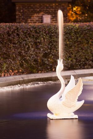 historic district: Spouting White Swan Figure of Forsyth Park Fountain famous landmark at night in Historic District of City of Savannah, Georgia, USA Stock Photo