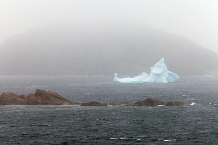 foul: Melting iceberg in foggy foul weather off the coast of New Foundland, Canada