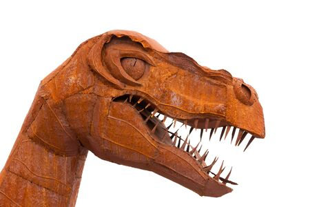 Tyrannus Saurus Rex dinosaur rusty iron sheet metal model head with sharp teeth on white background