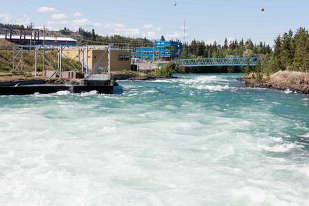 torrential: Violent white water in spillway of hydro-electric power plant of the small scale hydro station at Whitehorse, Yukon Territory, Canada
