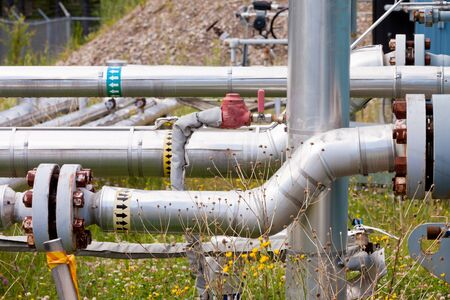 Outdoor piping system with rusty bolts in the sun Stock Photo