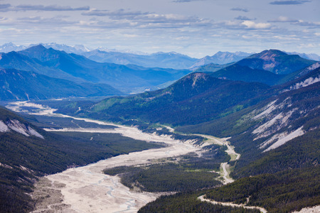 Aerial view of MacDonald Creek valley and Alaska Highway in Stone Mountain Provincial Park, British Columbia, Canada Stock Photo