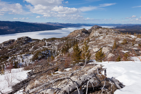 boreal: Boreal forest taiga wilderness with still frozen ice surface of Lake Laberge end of April at spring time in the Yukon Territory, Canada Stock Photo