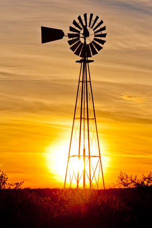 western usa: Windpump windmill water pump at sunset in Western Texas, USA