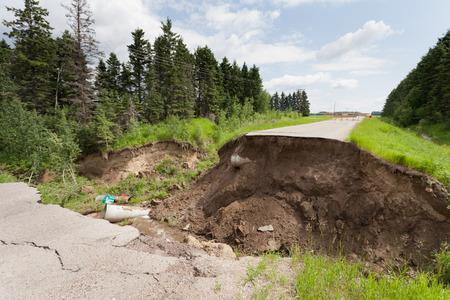 washed out: Washout: rain flood damaged badly washed out road