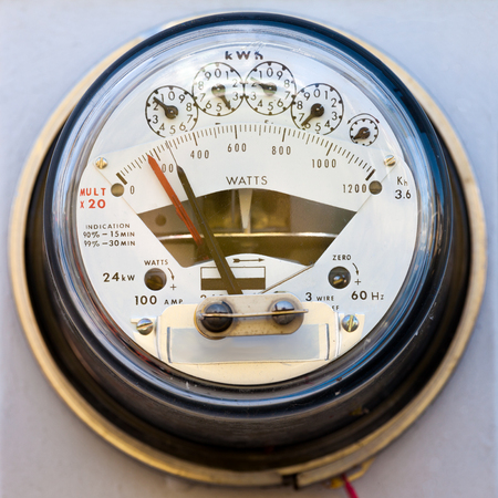 electric grid: Dial type residential household power supply electricity kWh meter closeup for details