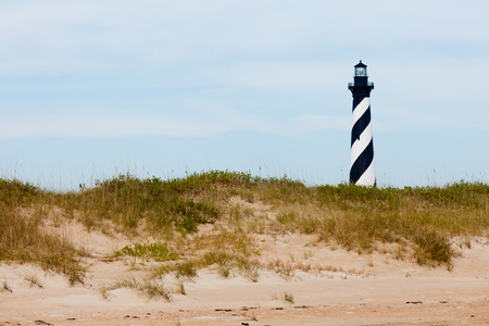 north carolina: Cape Hatteras Lighthouse towers over beach dunes of Outer Banks island near Buxton, North Carolina, US