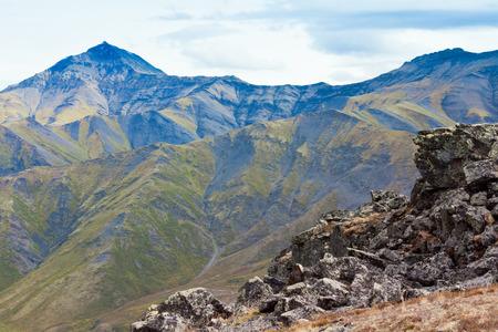 yukon territory: Natural landscape of fall colored alpine tundra wilderness habitat in high mountain range of Tombstone Mountains, Yukon Territory, Canada