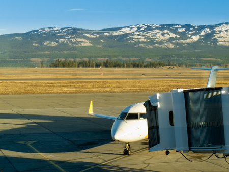 whitehorse: Airliner ready for boarding on Whitehorse international airport, Yukon Territory, Canada Stock Photo