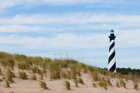 hatteras: Cape Hatteras Lighthouse towers over beach dunes of Outer Banks island near Buxton, North Carolina, US