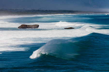 west  coast: Turbulent water of breaking ocean waves and spray on incoming ocean surf on West Coast of New Zealand South Island