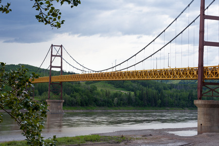 water transportation: Suspension bridge at Dunvegan spans mighty Peace River, Alberta, Canada Stock Photo