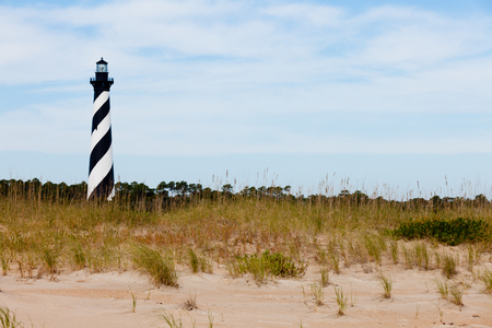 light house: Cape Hatteras Lighthouse towers over beach dunes of Outer Banks island near Buxton, North Carolina, US