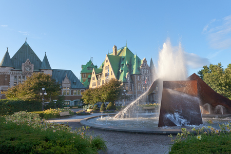 Fountain in front of historic building landmark of Gare du Palais railway station in Quebec City, Canada