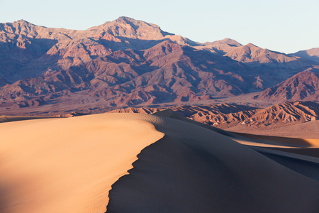 sand dunes: Mesquite Sand Dunes and colorful mountains in Death Valley National Park, California, USA
