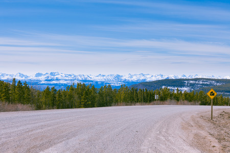 rocky mountain: Snowy peaks of Northern Rockies landscape, Alaska Highway at Steamboat, British Columbia, Canada Stock Photo
