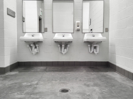 privy: Simple but clean public washroom, row of sinks and mirrors, grungy faded-color mobile shot