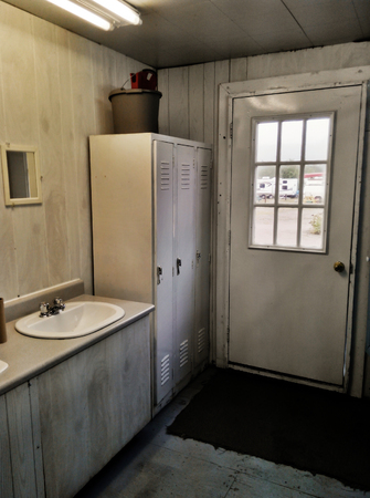 privy: Inside public washroom house on a campground grungy faded-color mobile shot Stock Photo