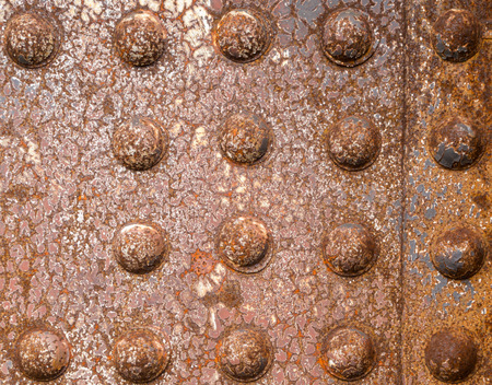 iron oxide: Rusty rivets of iron riveted steel construction background texture pattern Stock Photo