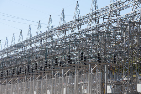 power industry: High-voltage transformer station serving the electric power grid energy industry background pattern Stock Photo