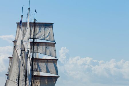 Marine or nautical background of a three masted barquentine yacht, square rigged on the foremast, with sails and rigging detail Stock Photo