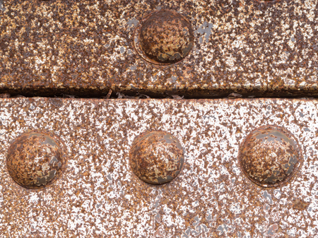 corrosion: Grungy iron steel construction rusty rivets background texture pattern