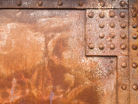 steel sheet: Heavily corroded iron panel of a riveted steel construction background texture pattern Stock Photo