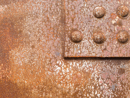 ironworks: Rusted surface iron panel of a riveted steel construction background texture pattern
