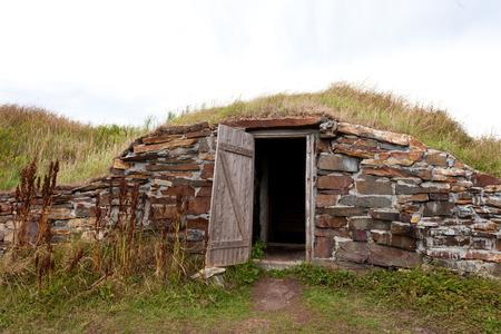 historic vintage: Open door historic vintage root cellar dug underground near Elliston, Newfoundland, NL, Canada