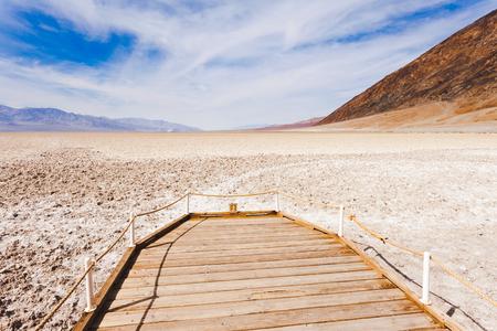 valley below: Badwater Basin public boardwalk lowest point below sea level of Death Valley desolate desert landscape, Death Valley National Park, California, CA, USA