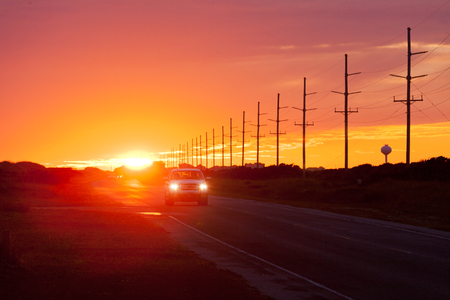 obx: Beautiful US Atlantic Coast sunset and car traffic on Highway 12 on Hatteras Island of Outer Banks, OBX, North Carolina, NC, US Stock Photo