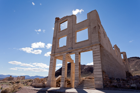 Bank building ruins in Rhyolite, Nevada, USA, ghost town in Mojave Desert near Death Valley National Park Stock Photo